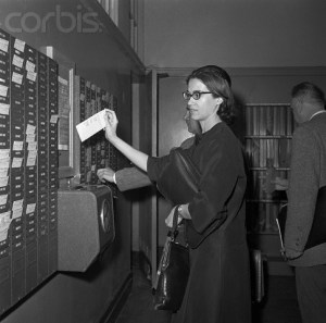 Punching the clock  (Image by © Bettmann/CORBIS)